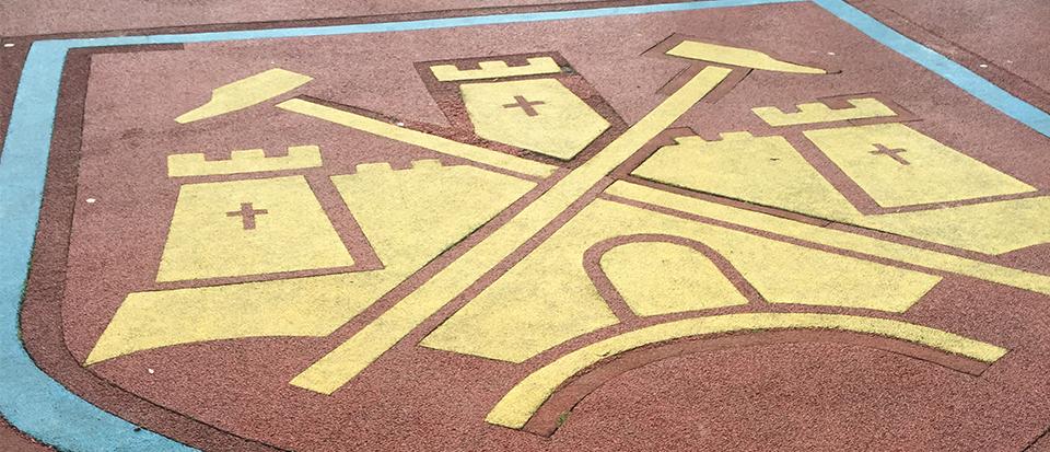 West Ham logo on the pitch at Boleyn Ground