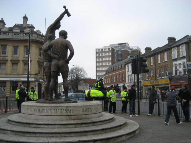 The Champions sculpture with mounted police in the background