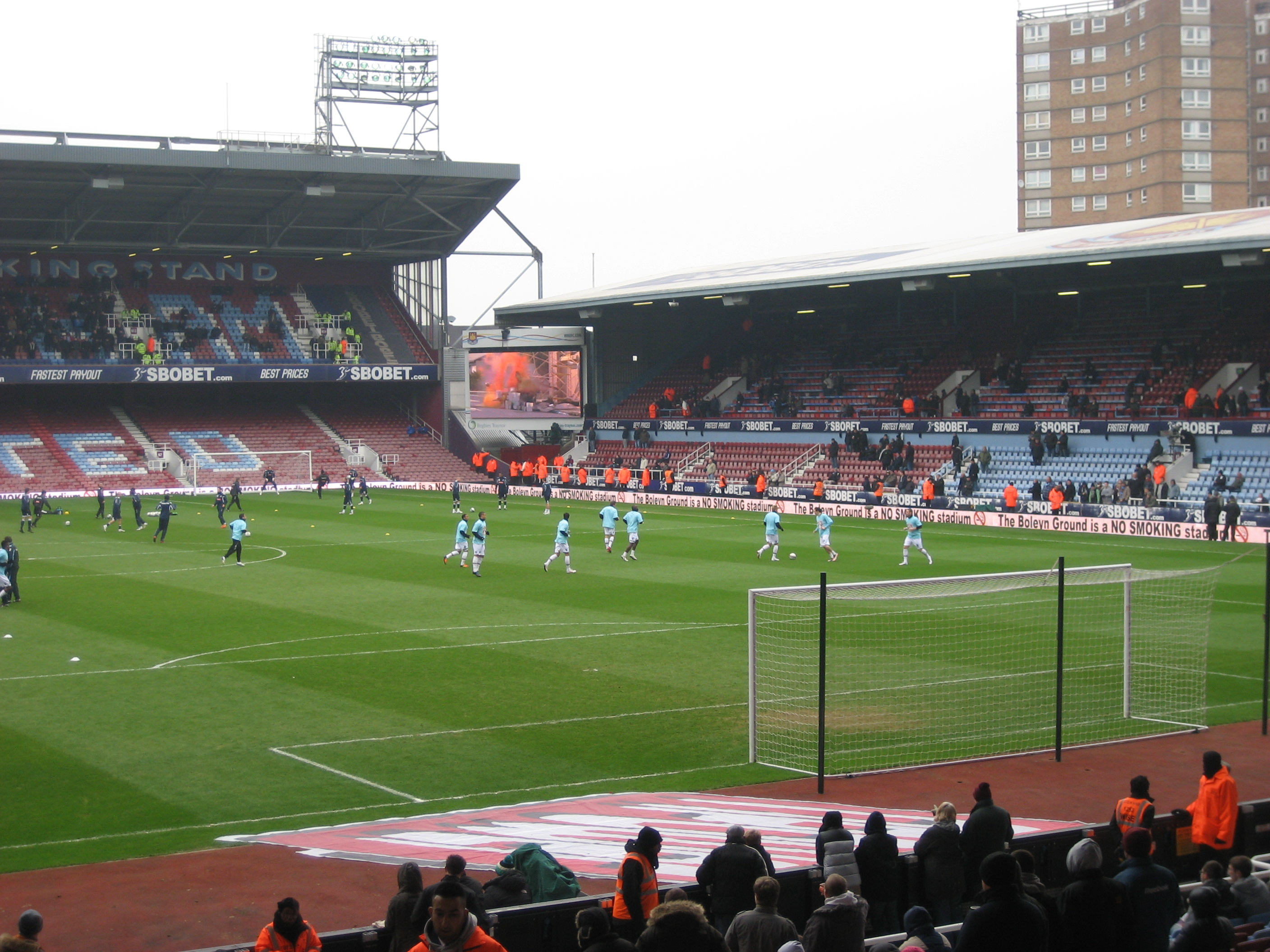 Millwall warming up in front of the East Stand