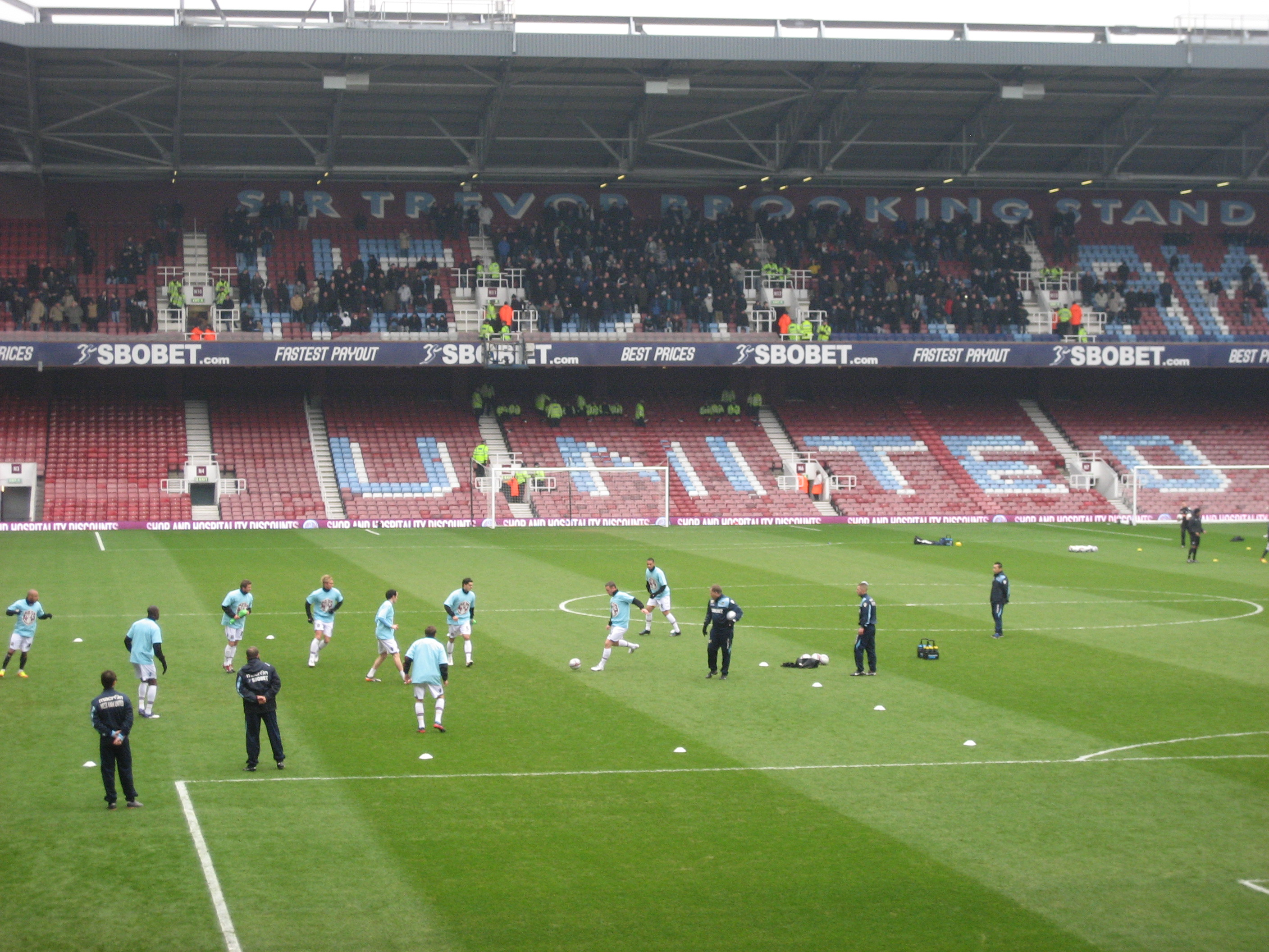 MIllwall warming up in front of their supporters